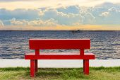 Empty Red Chair And Twilight Sea View Background poster
