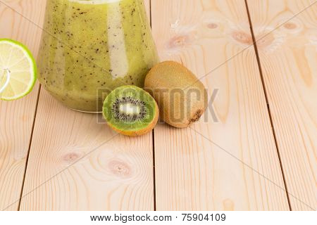 Kiwi juice on the wooden desk closeup poster
