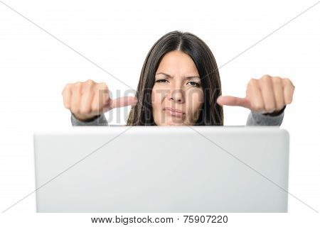 Unhappy Young Woman Showing Thumbs On Sides