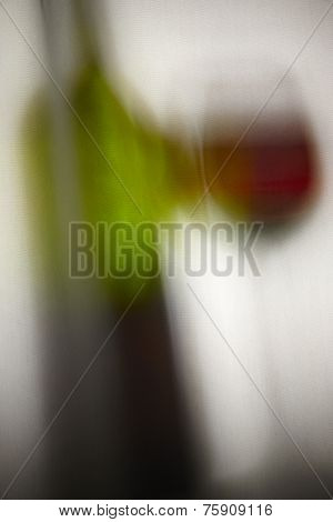Reflection Of A Bottle And A Cup Of Red Wine