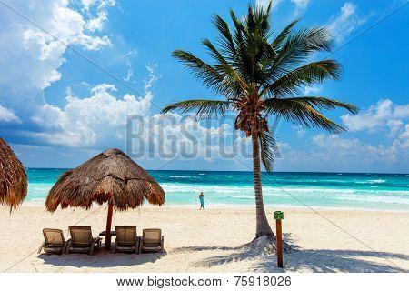 Beautiful tropical white sand beach and Caribbean sea in Tulum Mexico