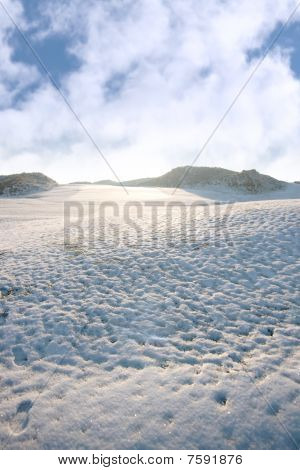 Footprints On A Slippery White Snow Covered Course