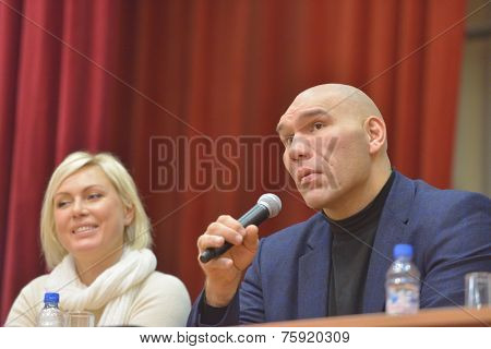 NOVOSIBIRSK, RUSSIA - NOVEMBERr 8, 2014: World champions in boxing Nikolay Valuyev and Natalia Ragozina talk with children. The meeting dedicated to the Friendship Cup and aimed to promote the sport