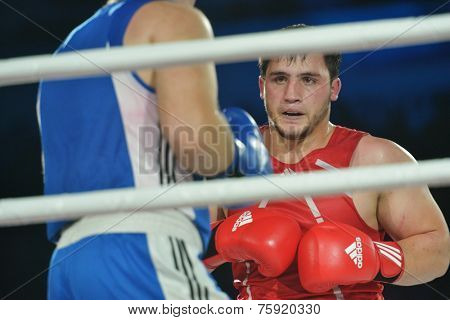 NOVOSIBIRSK, RUSSIA - NOVEMBER 8, 2014: Boxing match Rashid Kodzoyev (red) vs Alexey Emelyanov during the Friendship Cup. The competitions include 10 kinds of martial arts