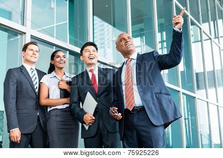Indian Leader explaining his vision giving outlook to his business team in Asia
