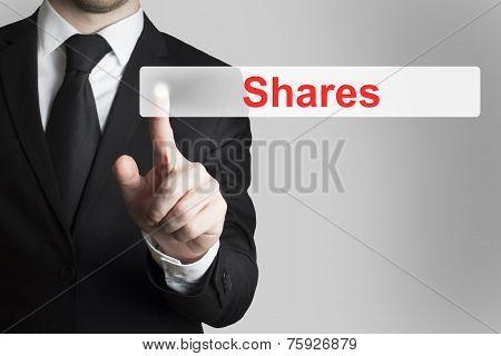 Businessman Pushing Flat Touchscreen Button Shares
