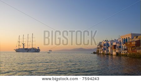 Little Venice On Mykonos And The Cruise Boat At Sunset