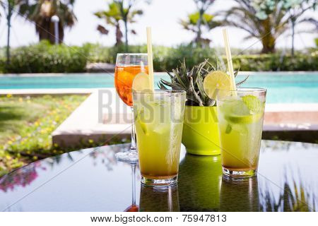 Two Mojitoes With Glass Of Aperol Spritz At Background