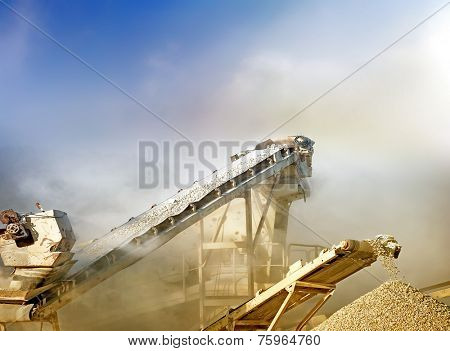 Crushing stones for gravel production on mining quarry