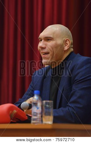 NOVOSIBIRSK, RUSSIA - NOVEMBER 8, 2014: World champion in boxing Nikolay Valuyev talks with children. The meeting dedicated to the Friendship Cup and aimed to promote the sport