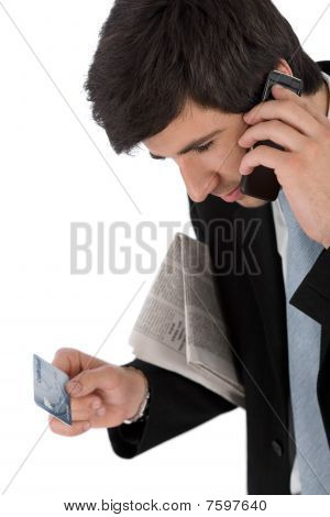 Young Businessman Holding Mobile Phone And Credit Card