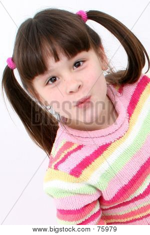 Seven Year Old Girl Striped Sweater Blowing Kiss