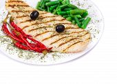 A close-up view of a grilled salmon steak served with peas and red pepper poster