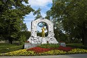 Vienna's Johann Strauss statue located at Stadtpark poster