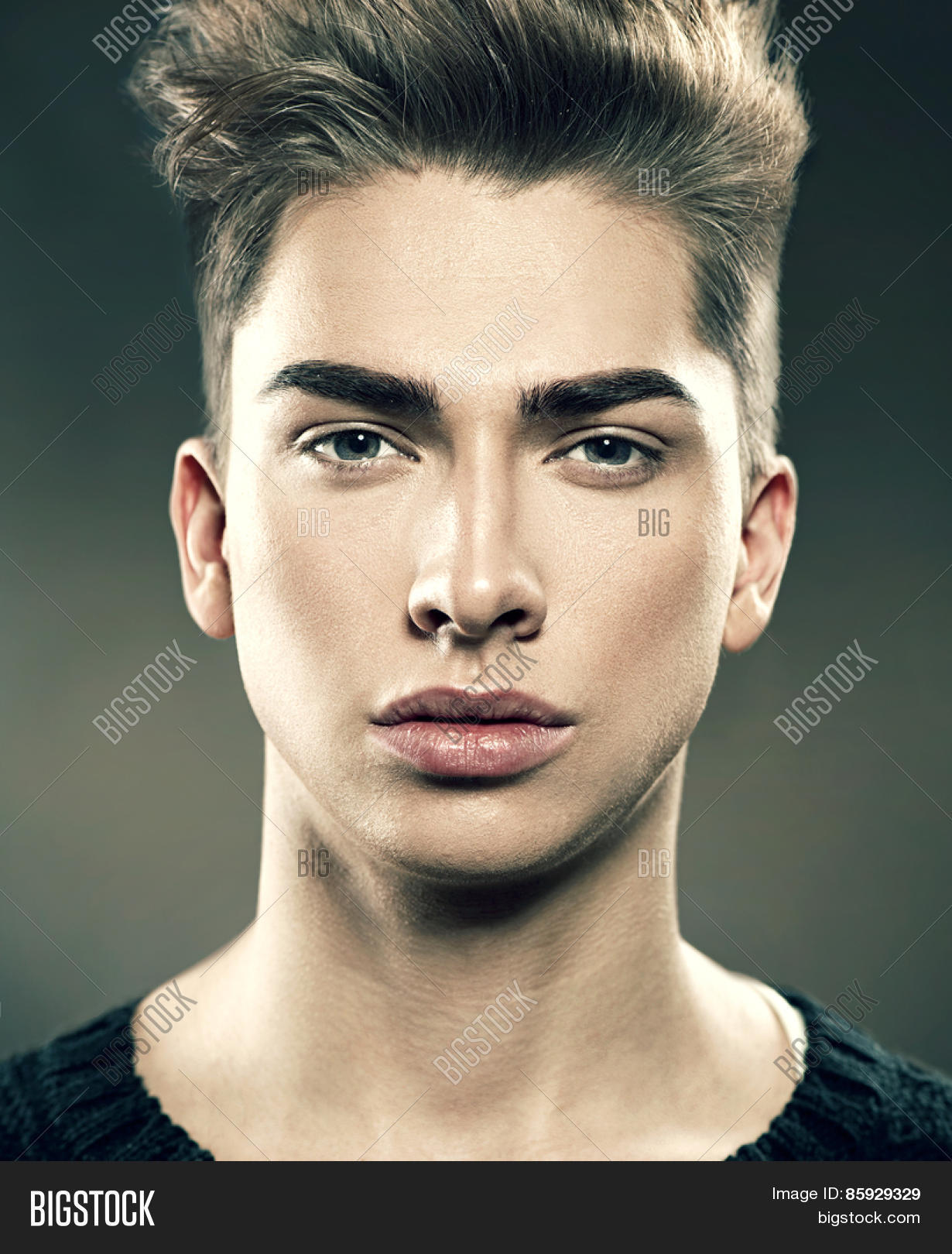 Handsome young fashion model man portrait attractive guy face closeup vogue style image of