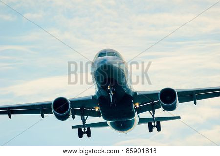 Passenger Airplane In The Sky With Prepared Gear And Flaps