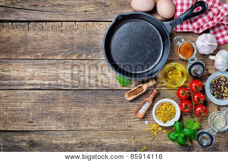 Ingredients for cooking and cast iron skillet