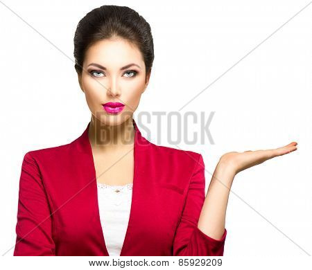 Young beauty business woman showing empty copy space on the open hand palm for text, white background. Happy girl presenting point watching on it. Proposing a product. Gestures for advertisement