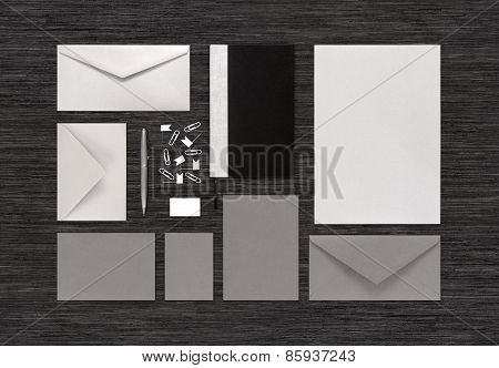 Top View Of Blank Stationery And Branding Corporate Identity Mock-up On Black Office Table