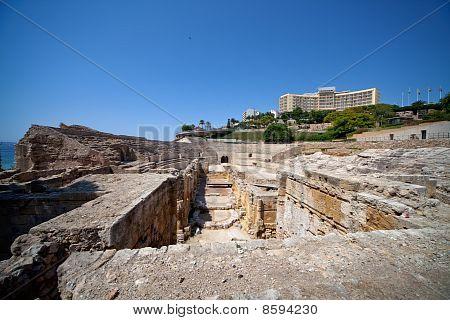Ruins Of Ancient Roman Amphitheater Era In Tarragona, Spain
