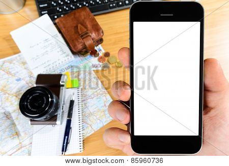 getting ready with smart phone for travel, money, map and photo camera on wooden table with copy space