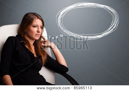 Beautiful young lady thinking about speech or thought bubble with copy space