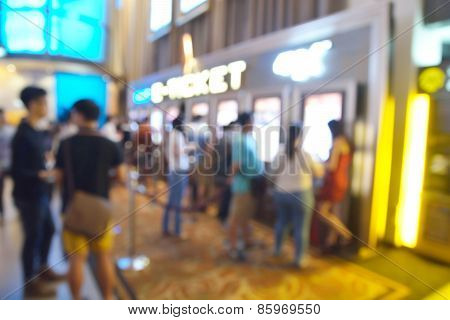 Blur Or Defocus Image Of People Line Up To Buy Movie Ticket From E-ticket Or E-machine System