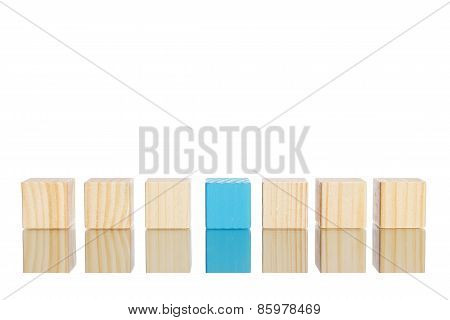 Wooden Blocks Standing In Line With Blue One In The Centre
