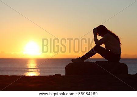 Sad Woman Silhouette Worried On The Beach