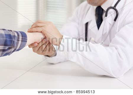 Doctor reassuring his female patient