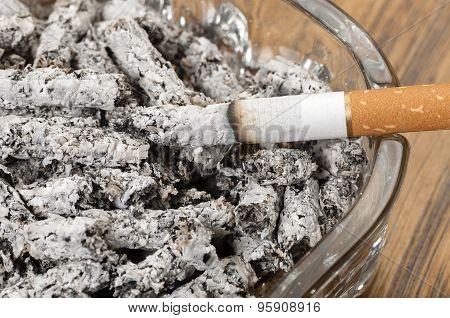 Cigarette Ashes In An Ashtray And Cigarette