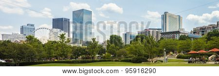 ATLANTA, GEORGIA-JUNE 30, 2015: Unidentified people enjoy downtown Atlanta Georgia with the iconic skyline in the background