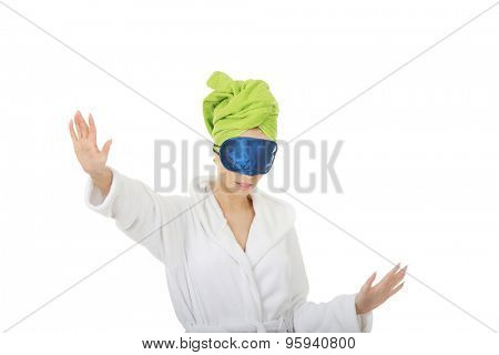 Sleepwalking woman in bathrobe and sleep bandage.