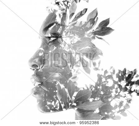 Double exposure portrait of attractive woman combined with photograph of nature