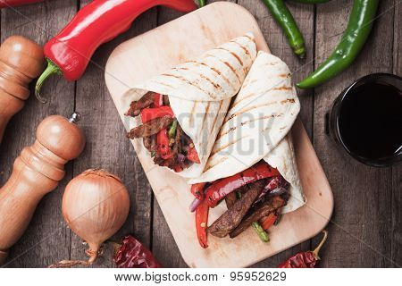 Mexican fajitas, spicy beef and vegetable in tortilla wrap