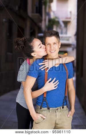 Young romantic couple in a urban background with a hipster style. El Born, Barcelona