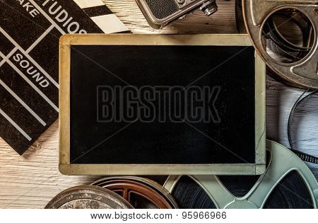Retro film accessories with blank blackboard for copyspace poster