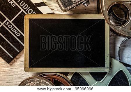 Retro film accessories with blank blackboard for copyspace