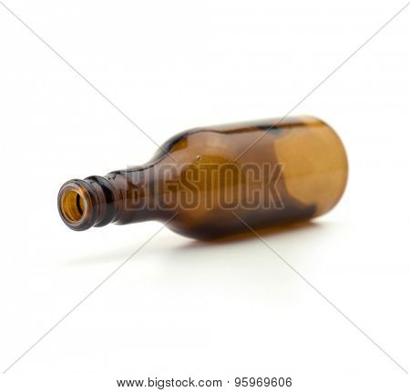 Brown transparent glass bottle, isolated on white. Focus on bottle tip.