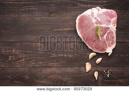 Top View Raw Pork Chop Steak And Garlic, Pepper On Wooden Background