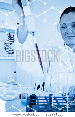 Science graphic against cute female biologist holding a manual pipette with sample from test tubes
