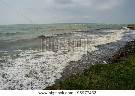 landscape by the sea, choppy water,  lowering sky