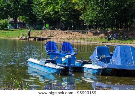 Urban recreational lake park and catamarans in water poster