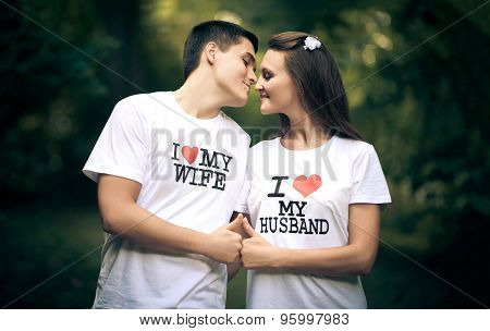 Young husband and wife with the words on the T-shirt I love my wife, I love my husband poster