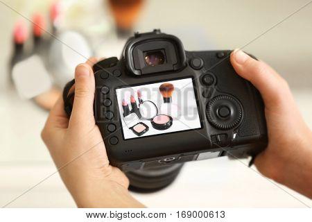 Photo of makeup kit on camera display while shooting