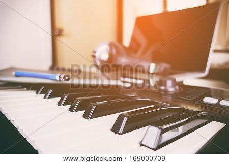 Synth keyboard in a home music studio