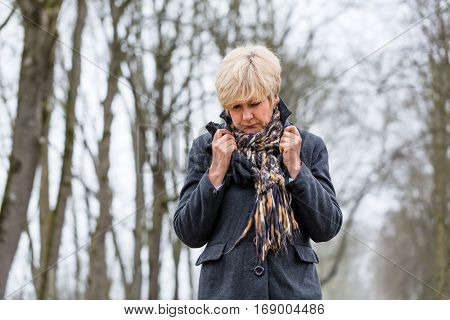 Depressed or sad woman walking in winter