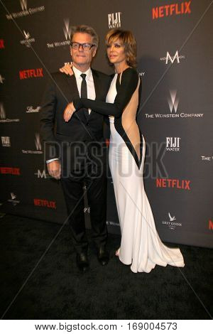 Harry Hamlin and Lisa Rinna arrive at the Weinstein Company and Netflix 2017 Golden Globes After Party on Sunday, January 8, 2017 at the Beverly Hilton Hotel in Beverly Hills, CA.