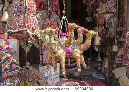 hanging display of art crafts doll of shopfront in Pushkar Rajasthan India.