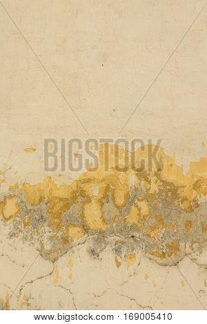 abandoned yellow fracture of exterior wall of house